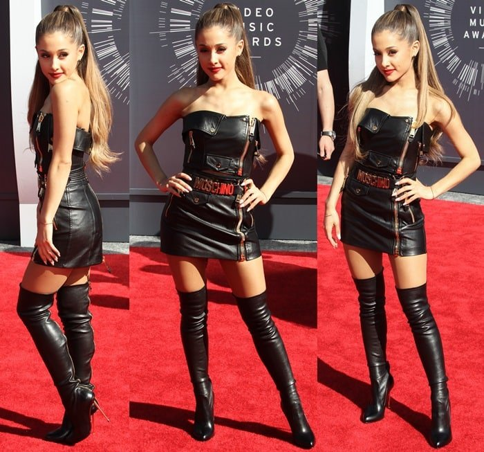 Ariana Grande in a sexy black leather mini dress from the Moschino Resort 2015 collection
