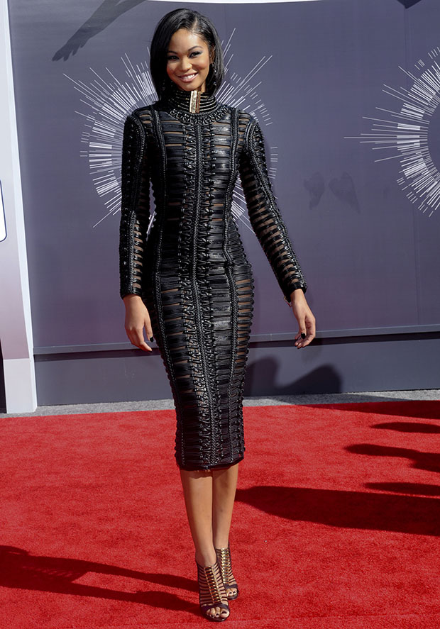 Chanel Iman in a fitted leather woven dress with long sleeves and a high neck from Balmain's Fall 2014 collection