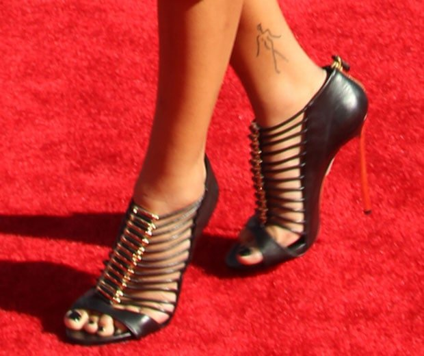 Completing Chanel Iman's futuristic bondage look were cage sandals from Casadei