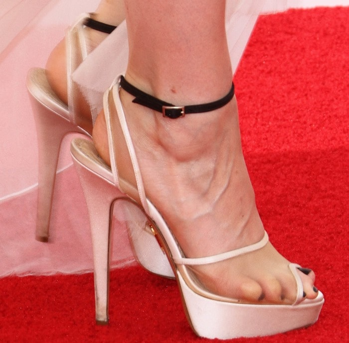 Kate Mara's white satin 'Pomeline' sandals feature sheer nude panels and thin black suede ankle straps