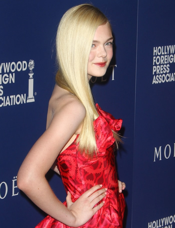 Elle Fanning donned a Vivienne Westwood Gold Label dress that has the designer's iconic squiggle print