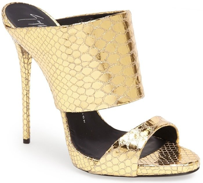 A snake-textured goldtone finish heightens the unmistakable glamour of a scene-stealing sandal set on a slim stiletto heel
