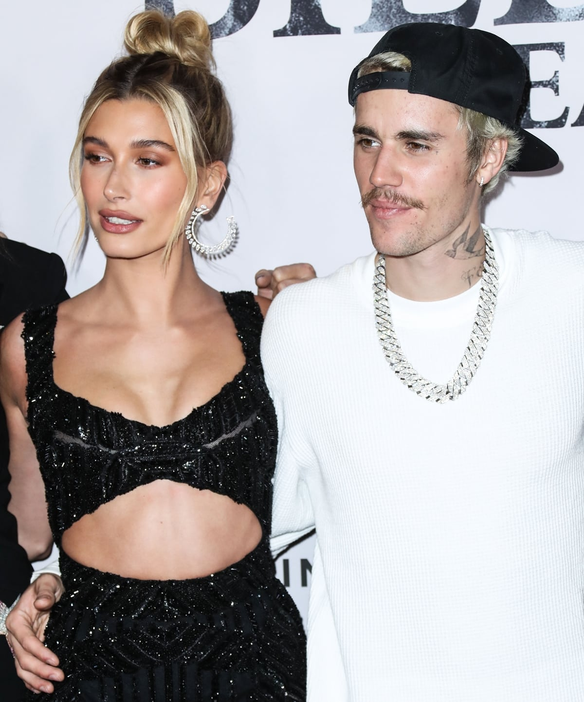When not wearing high heels, Hailey Bieber is about two inches shorter than her husband Justin Bieber