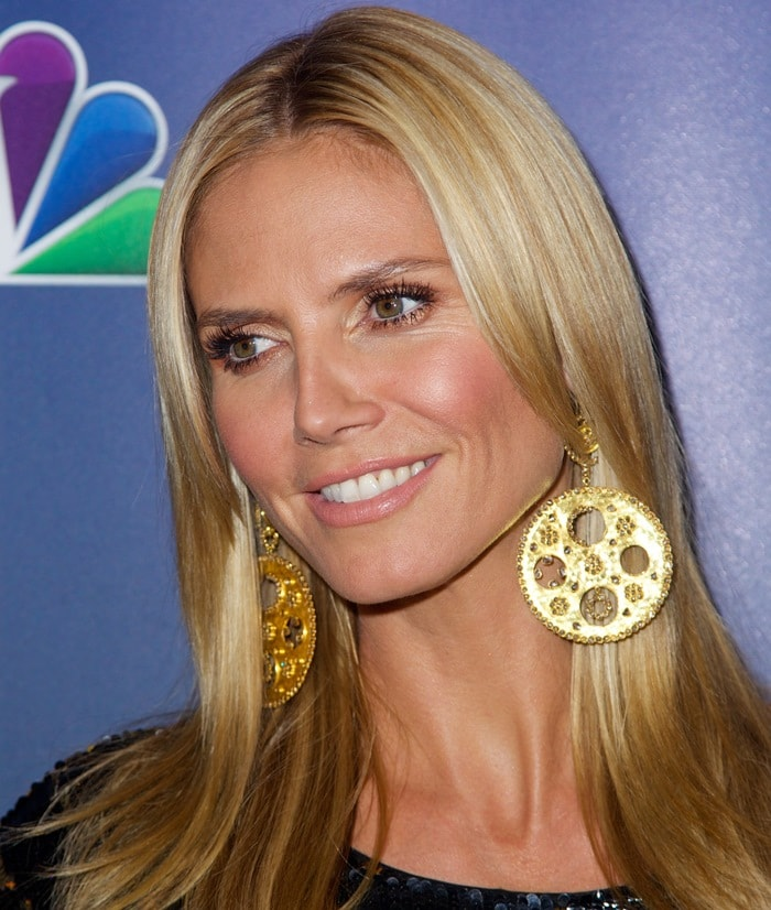 Heidi Klum showing off her gigantic gold earrings