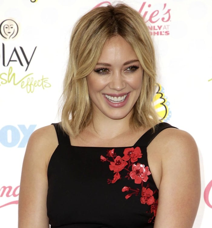 Hilary Duff in aSachin & Babi Noir Spring 2014 black crop top with red floral appliqués