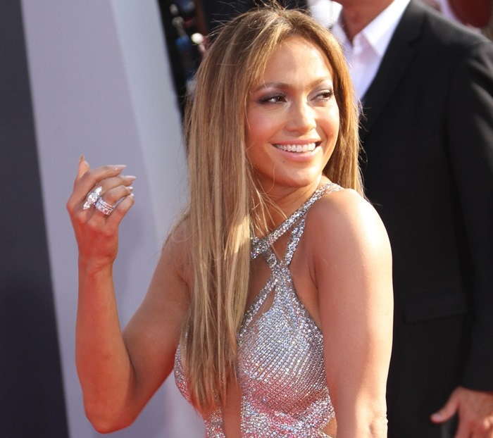 Jennifer Lopez donned a shimmering silver gown by Lebanese designer Charbel Zoe featuring a bodice with multiple cutouts