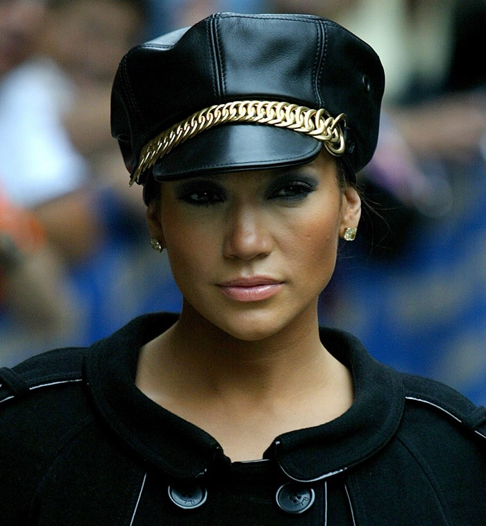 Jennifer Lopez wears an S&M-inspired leather cap with gold chain detail