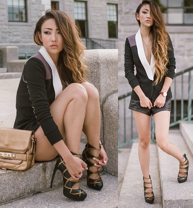 Jessica in a blazer and leather shorts with interesting cutout booties in brown and black