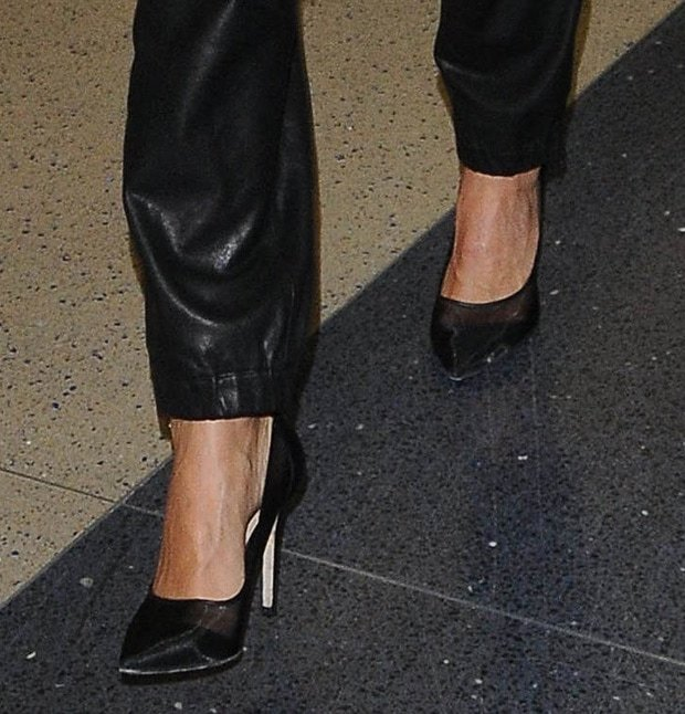 Jessica Alba shows off her feet in black pumps by Diane von Furstenberg