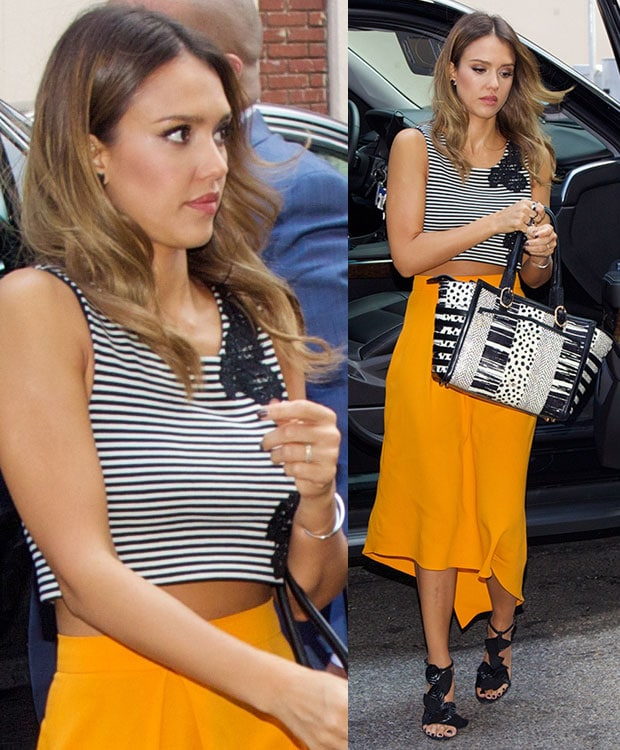 Jessica Alba styled the look with a selection of jewelry, a pair of black sunnies, and a Christian Louboutin tote