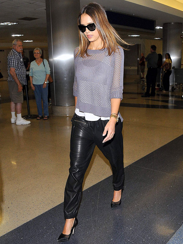 Jessica Alba wearing black Pam & Gela leather track pants