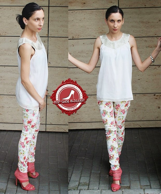 Justyna Zybek wearing a white top, floral pants, and strappy pink sandals