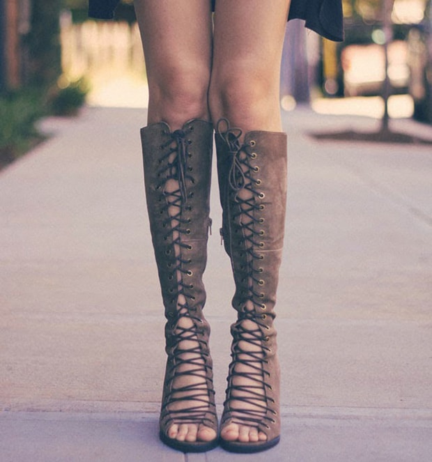 Kacie Cone in knee-high gladiator sandals