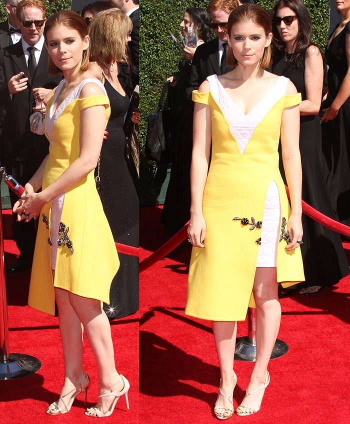 Kate Mara flashes her legs in a yellow embroidered wool and quilted crepe dress from Christian Dior