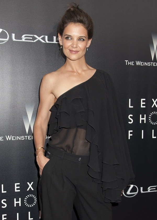 Katie Holmes donned a playful and flirty Michael Kors outfit that features an asymmetrical shoulder with ruffled layers and semi-sheer fabric