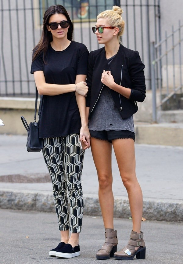 Kendall Jenner and her shorter friend Hailey Baldwin trying to hail a cab