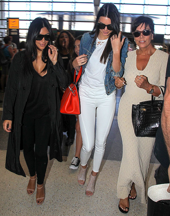 Kim Kardashian, Kendall Jenner, and Kris Jenner catching a flight out of LAX in Los Angeles, California, on July 31, 2014