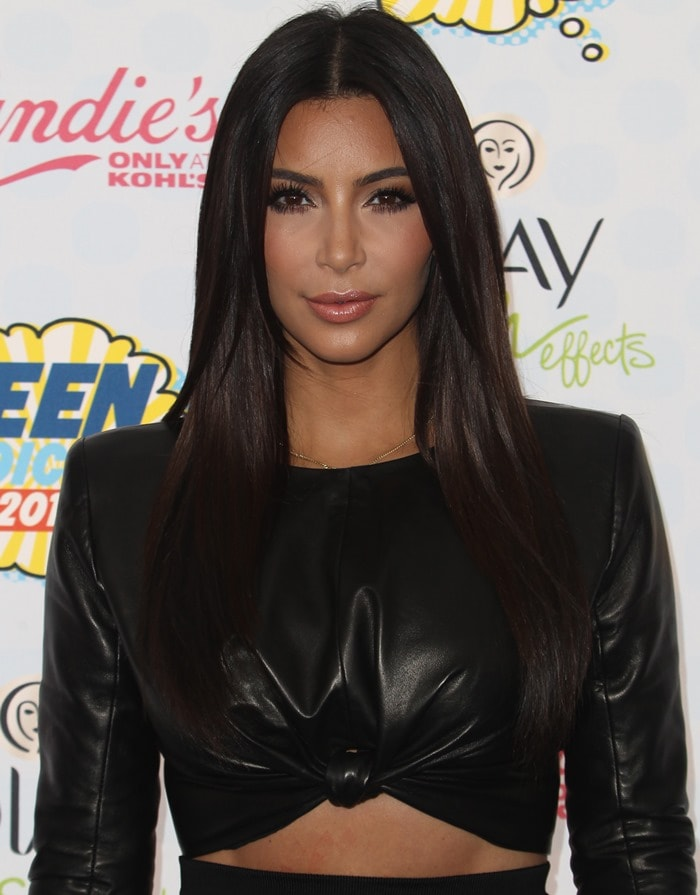 Kim Kardashian sported a cropped leather top by Balmain paired with a zebra-print straight skirt from the same brand