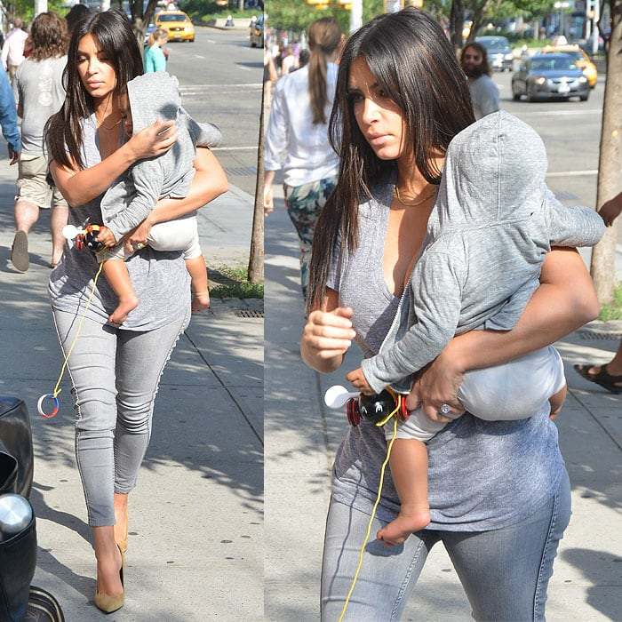 Kim Kardashian with baby North arriving at her apartment in Manhattan, New York City, on August 11, 2014