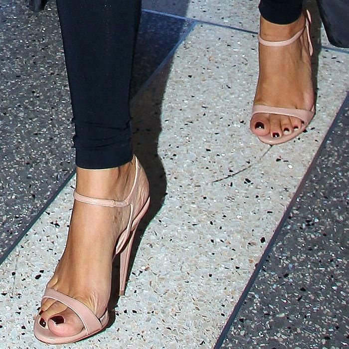 Nude patent Prada ankle-strap sandals on Kim Kardashian