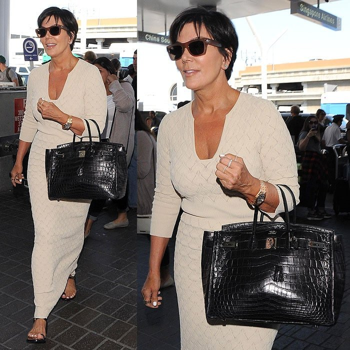 Kris Jenner's traveling outfit in brown and cream tones accented with black