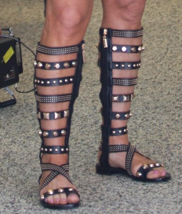 Kyle Richards's feet in Ivy Kirzhner gladiator sandals