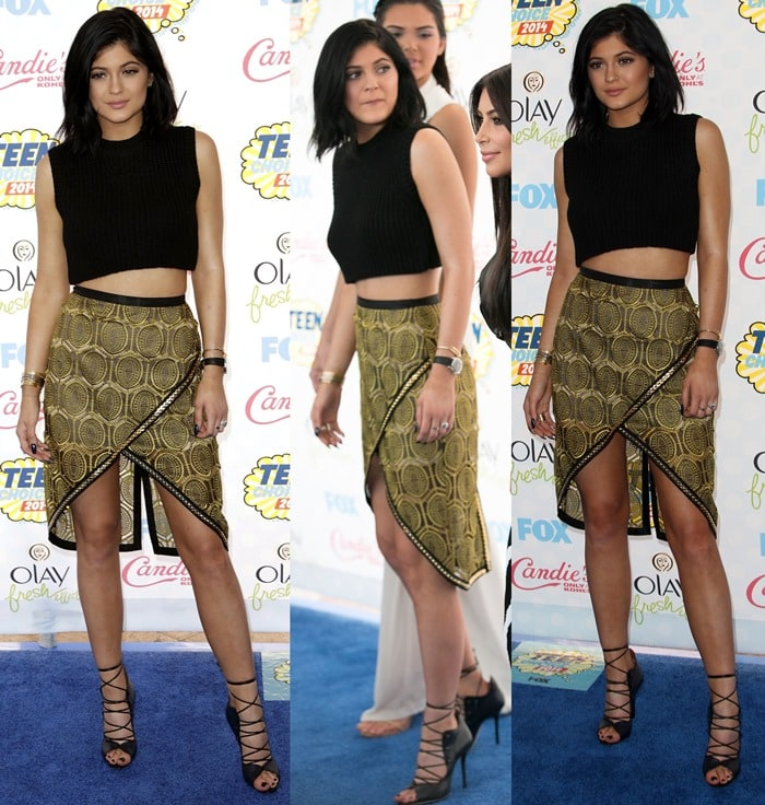 Kylie Jenner sported a gold-and-black printed skirt from the Sass & Bide Fall 2014 collection paired with a cropped black top