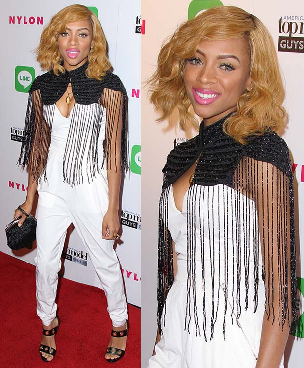 Lil Mama in a cleavage-baring white jumpsuit, which was styled with a black embellished and fringed cape for a hint of modesty