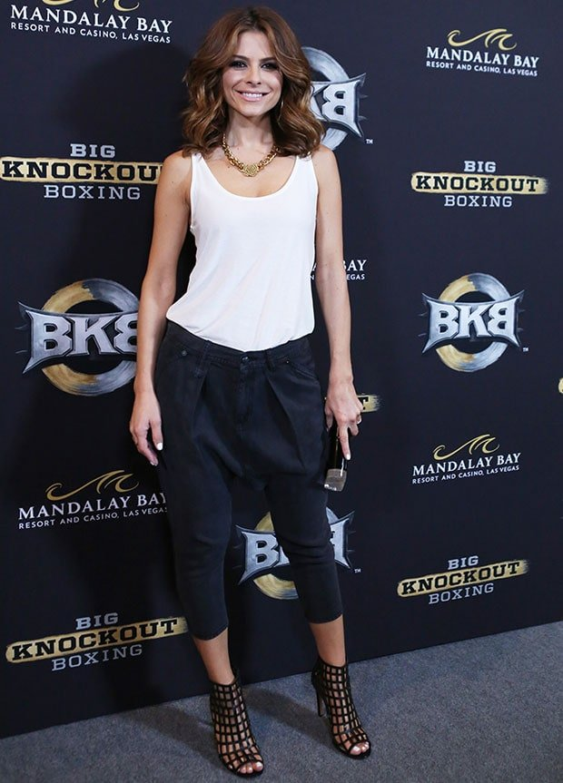 Maria Menounos wearing a pair of R13 denim harem pants and a white tank top