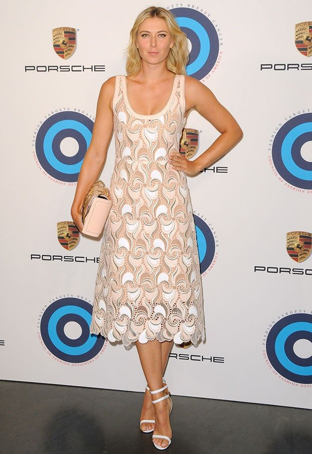 Maria Sharapova wore a summery Marc Jacobs dress in white with silver trims, intricate lace embroidery, and a cutout design
