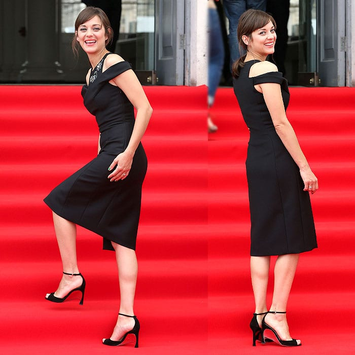 Marion Cotillard showing different angles of her Christian Dior fall 2014 open-shoulder dress to the cameras