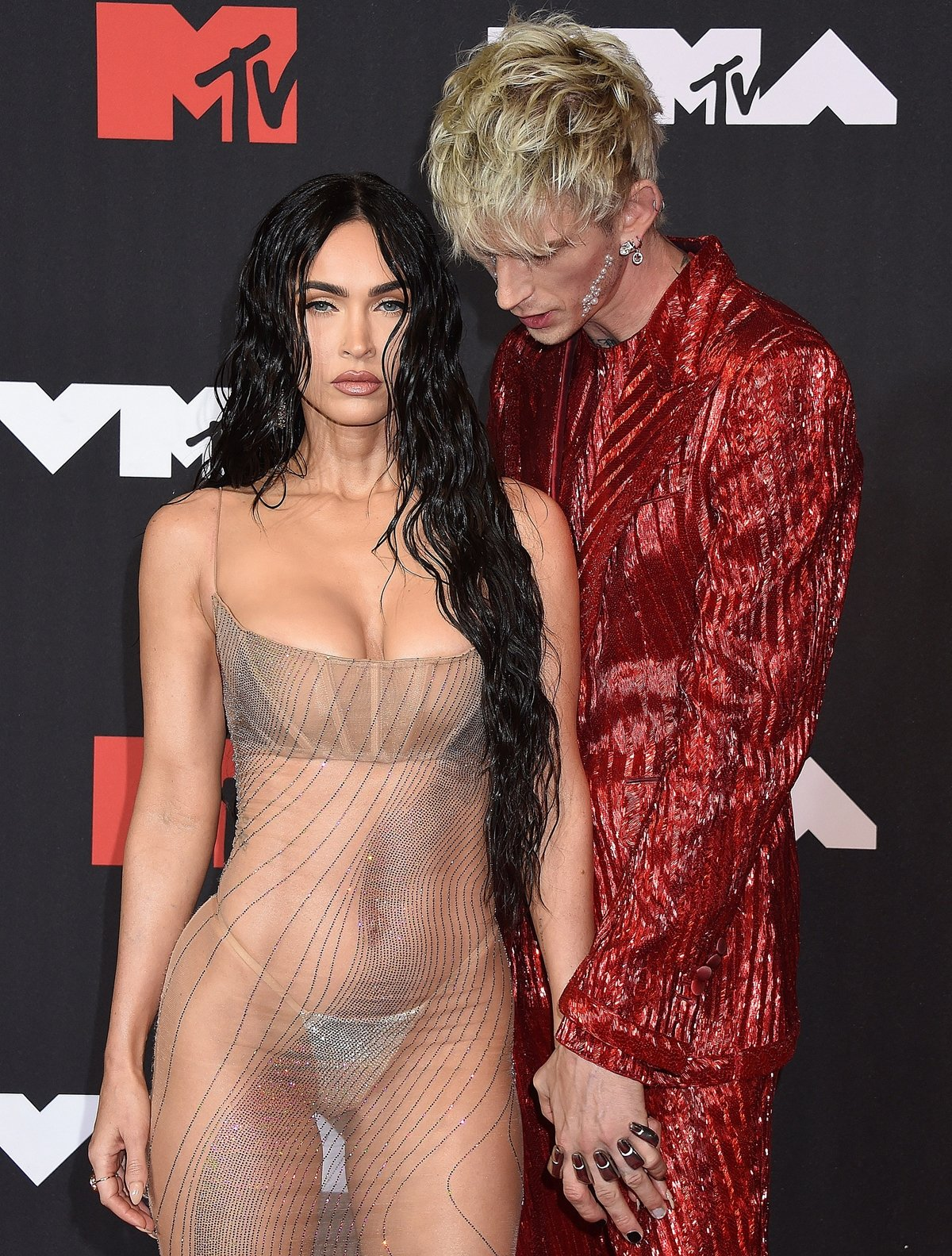 Machine Gun Kelly checking out her girlfriend Megan Fox's naked dress and embellished thong at the 2021 MTV Video Music Awards
