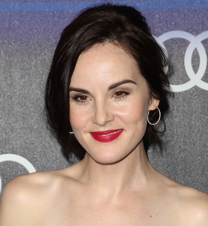 Michelle Dockery with messy hair and a splash of red lipstick