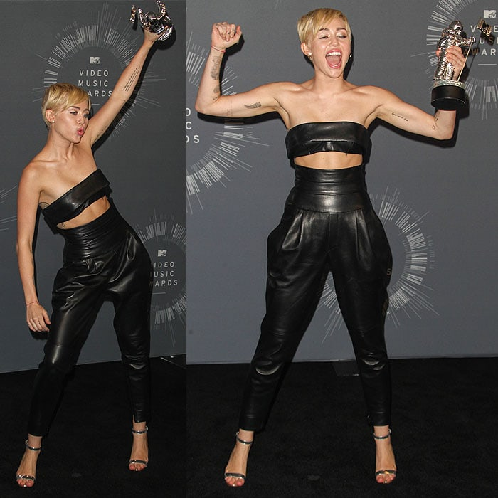 Miley Cyrus posing with her moonman trophy for the Video of the Year award inside the press room at the 2014 MTV Video Music Awards