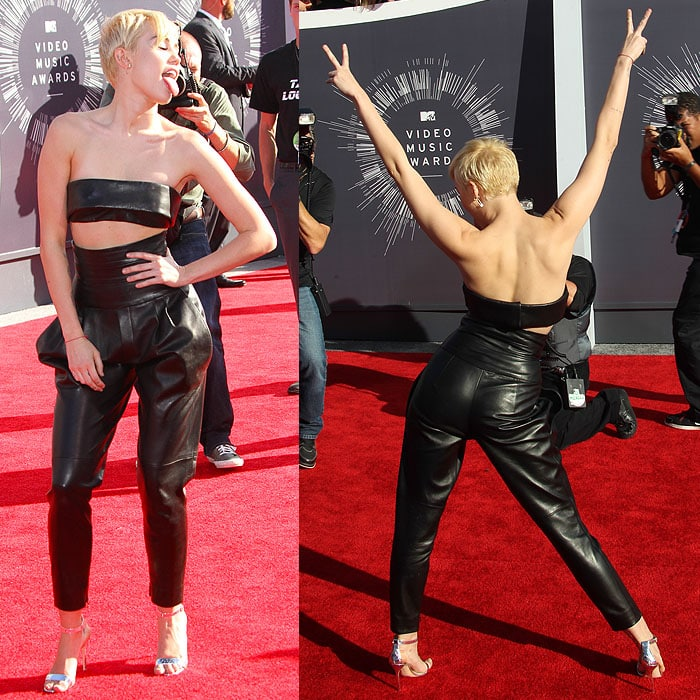 Miley Cyrus couldn't help but ham it up for the cameras and the crowd in an Alexandre Vauthier Fall 2014 couture leather bandeau and pleated high-waisted pants