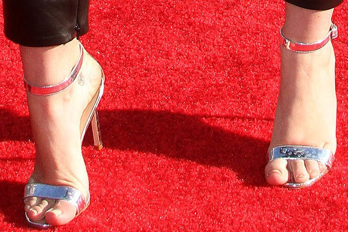 "Miley's Manolo Blahnik ""Chaos Holo"" sandals look about one or two sizes too small for her"