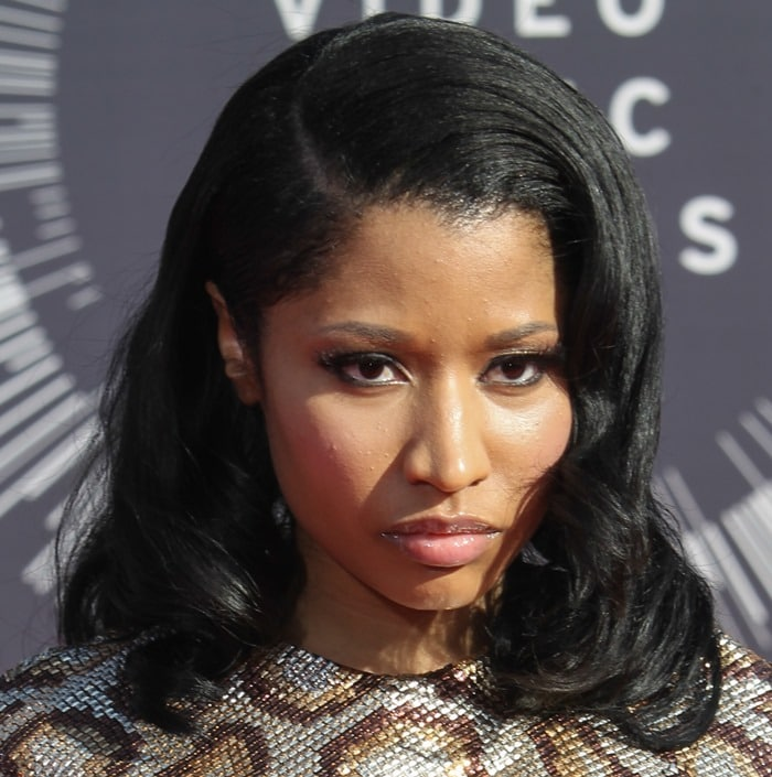 Nicki Minaj donned a python-print long-sleeve Saint Laurent mini dress