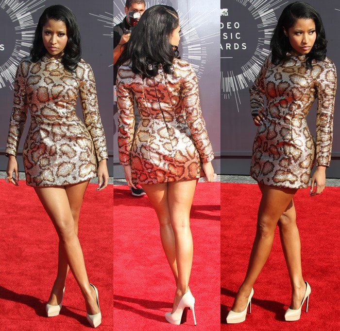 "Nicki Minaj donned a python-print long-sleeve Saint Laurent mini dress and classic ""Janis"" pumps"