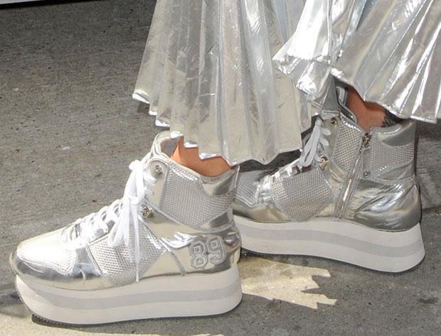 Rita Ora wearing DKNY platform sneakers