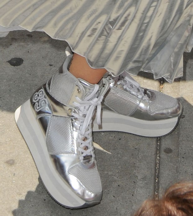 "Rita completed her space-age outfit with a pair of platform hi-cut sneakers called the ""Jansen,"" also by DKNY"