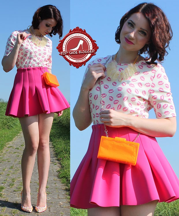 Rommy in a cute kiss-print top and a neoprene pink skirt