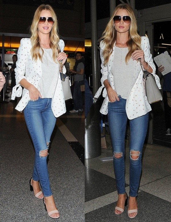 Rosie Huntington was spotted at LAX wearing a plain gray tee and distressed skinny jeans by Paige Denim that showed off her long legs