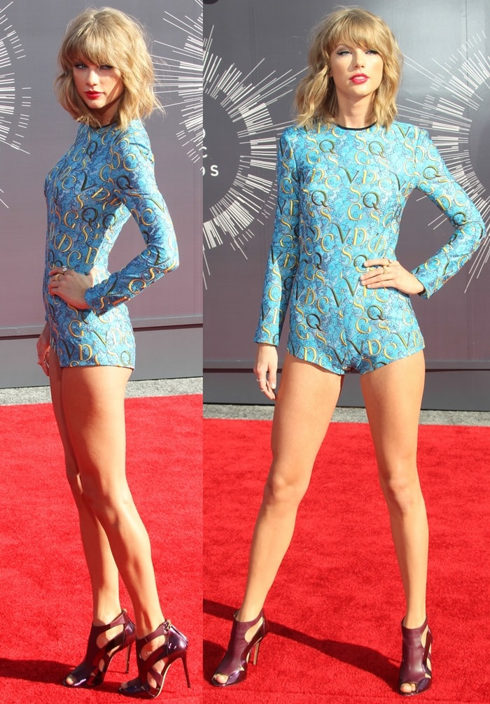 Taylor Swift in a long-sleeved playsuit by Mary Katrantzou featuring a high round neck and a letter-embroidered lace body