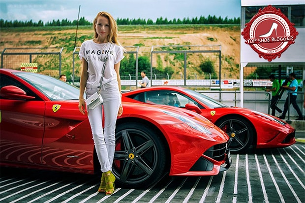 Tini Tani posing with a luxurious Ferrari car in the background