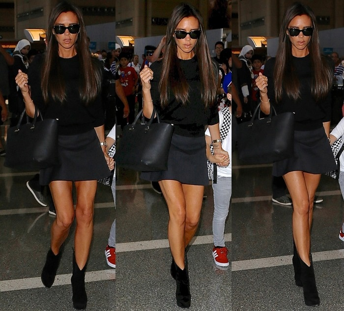 Victoria Beckham leaving LAX in a tiny miniskirt paired with a tucked-in black turtleneck jumper