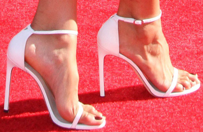 "Jordin Sparks sported white single-band ""Nudist"" sandals by Stuart Weitzman"