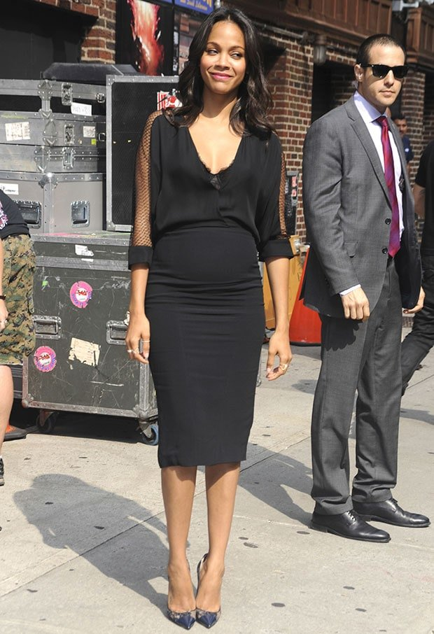 Zoe Saldana wore a form-fitting LBD from Monique Lhuillier's Resort 2015 collection featuring a deep-V neckline and sheer mesh sleeves