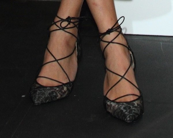 Alexa Chung shows off her feet in lace pumps