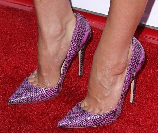 """Aubrey Plaza's feet inpurple snakeskinJimmy Choo""""Anouk"""" pumps"""
