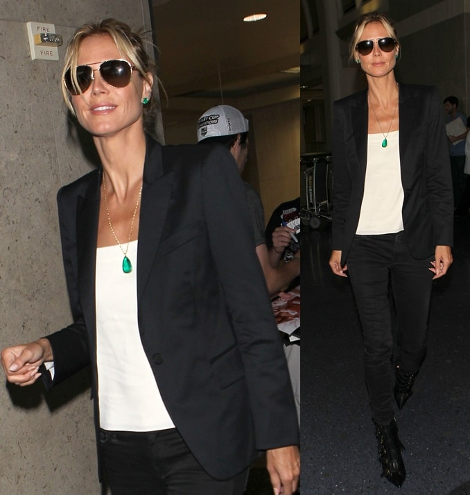 Heidi Klum opted for a monochromatic ensemble consisting of black skinny jeans worn with a white shirt and a black blazer